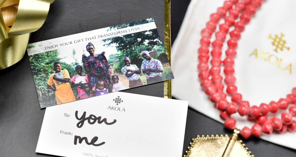A flatlay of jewelry and a thank you card from Akola, a small jewelry business