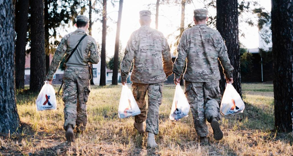 Military men walking with groceries