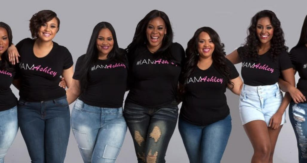 Ashley stewart and her team of ladies pose for a picture