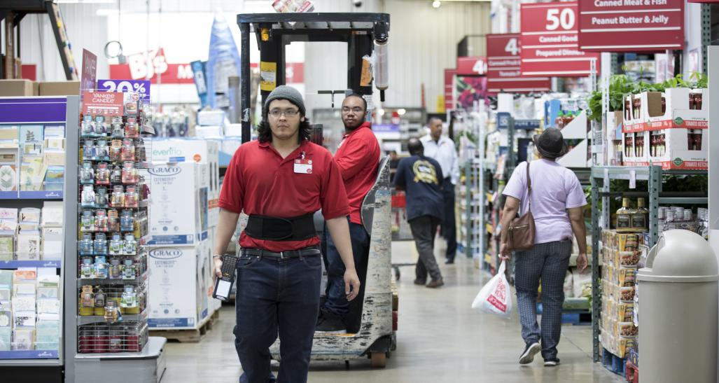 Employees working in warehouse store
