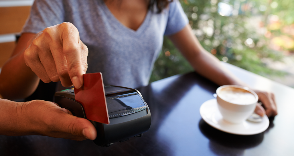 credit card swipe to pay for a coffee shop purchase