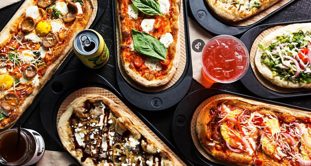 flatlay of pizza and drinks from &pizza
