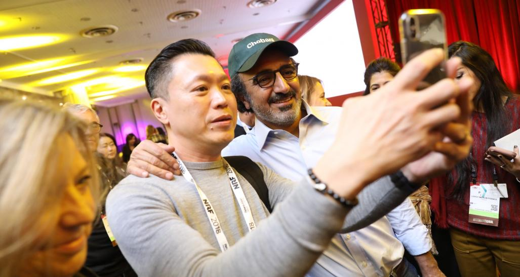 Chobani founder Hamdi Ulukaya takes a selfie with audience at NRF 2018