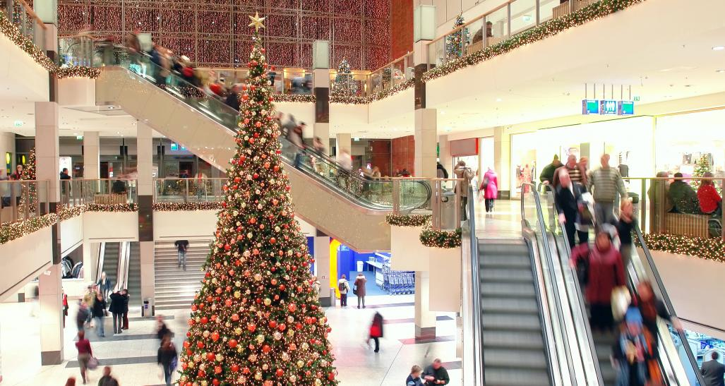 mall is shown during holiday season with christmas tree
