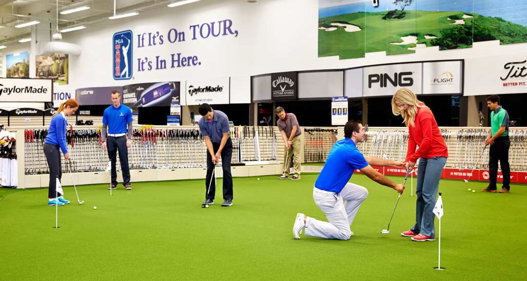 Golfers getting instruction at a PGA Tour Superstore