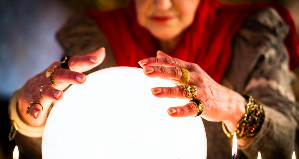 Woman looking in crystal ball