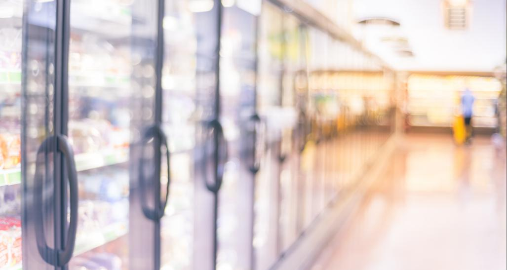 Blurred photo of frozen foods aisle in grocery store
