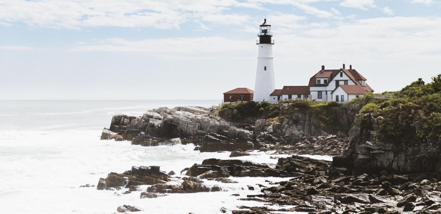 A lighthouse along the rocky coastline of Maine.