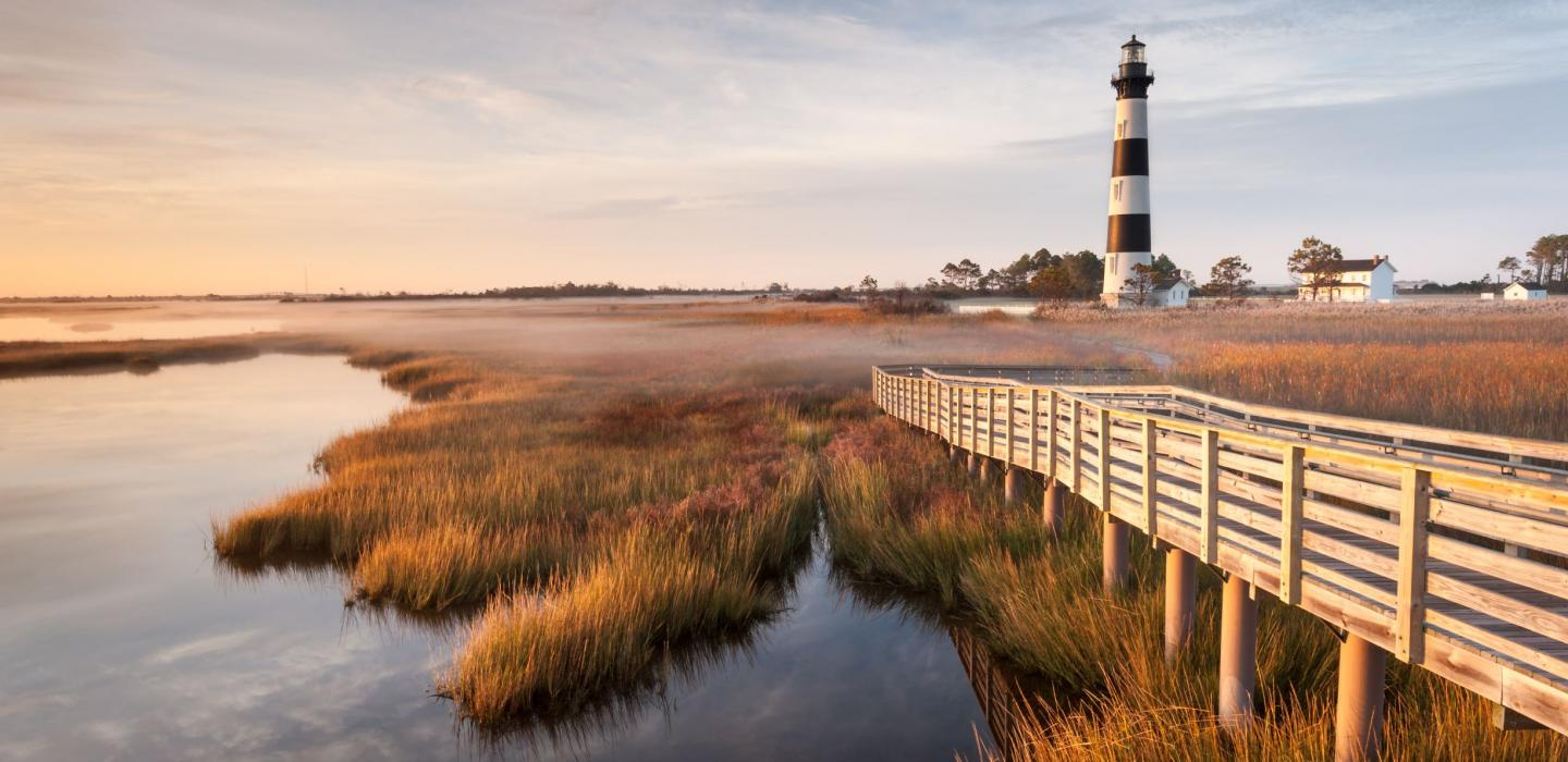 A lighthouse along the grassy plains of North Carolina.