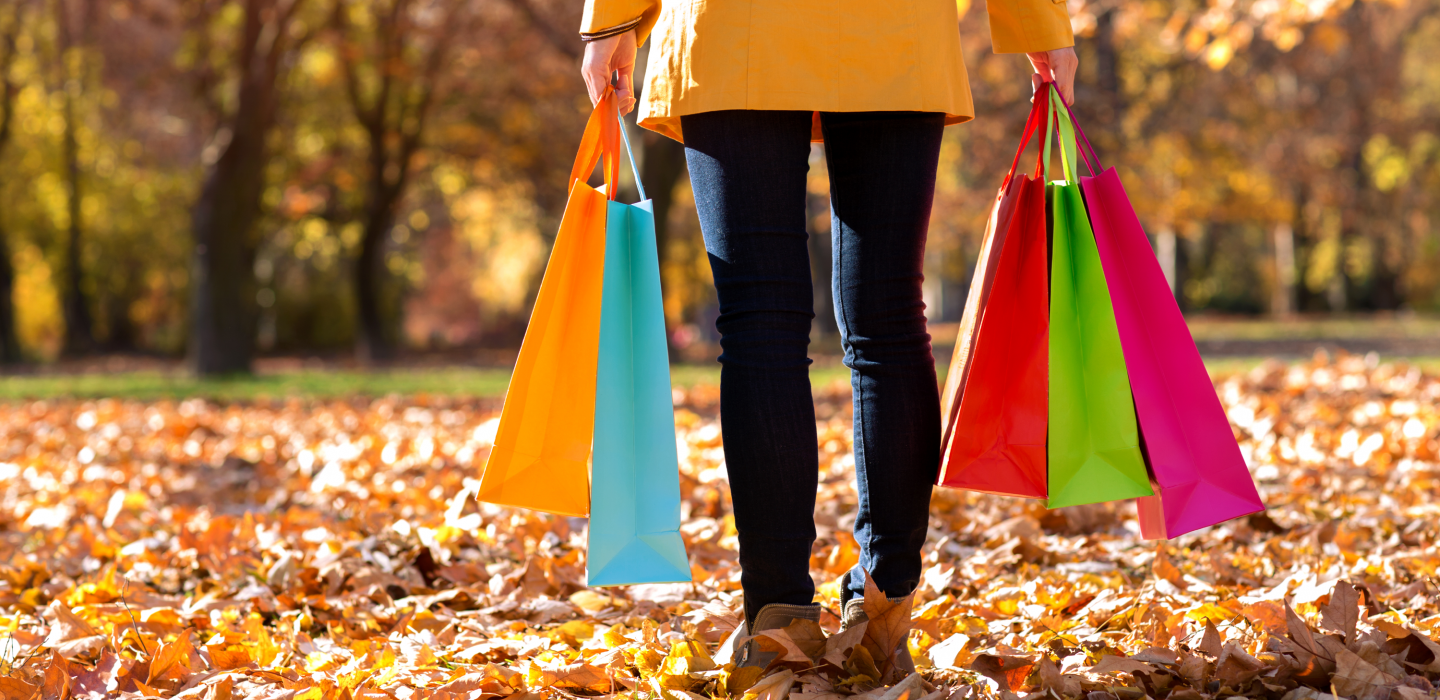 woman holding shopping bags in Fall