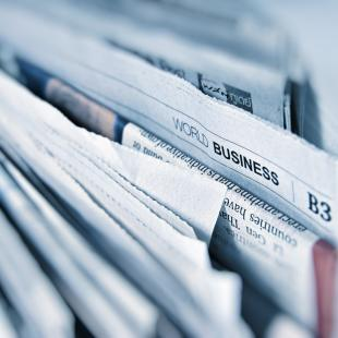 close up shot of newspapers
