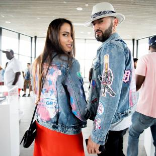 Two people pose for a picture in their Levis jean jackets