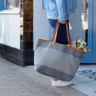 a lady holding a bag with flowers in it