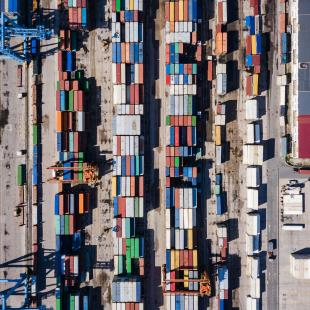 an aerial of shipment trucks at a port