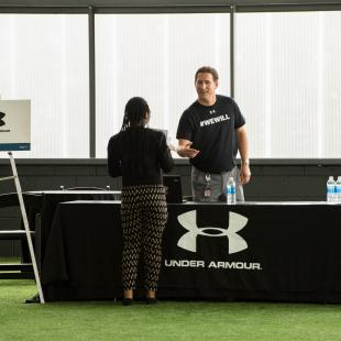 Under Armour recruiter speaks to rise up candidate at the Rise Up career fair