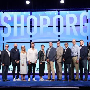 Shop.org innovation award winners stand on stage at shop.org in Las Vegas