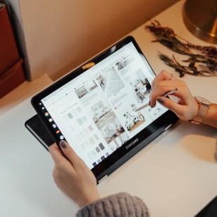 a closeup screen of a lady using pintrest on her ipad