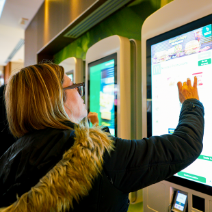 ordering food at a McDonald's self-service kiosk