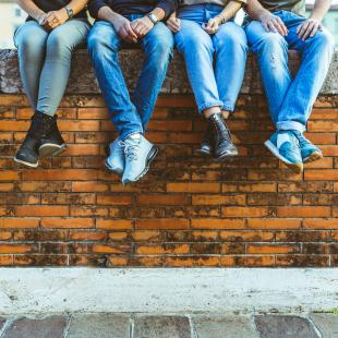 Jeans People sitting on brick wall
