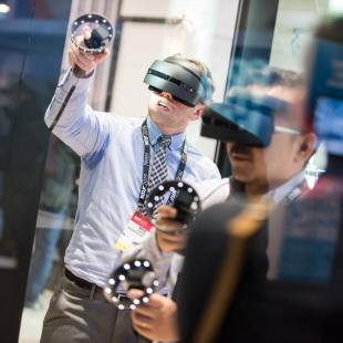 NRF 2019 Expo Hall two attendees testing AR-VR