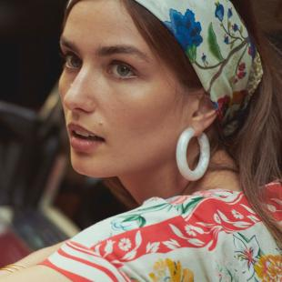 Anthropologie model wearing bandana and colorful shirt