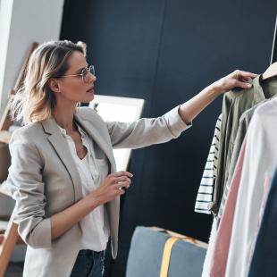 Woman looks at rack of clothing
