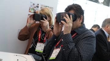 a woman and man look through virtual reality devices in the innovation lab at the big show