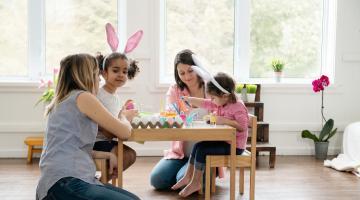 a family is shown with friends painting easter eggs