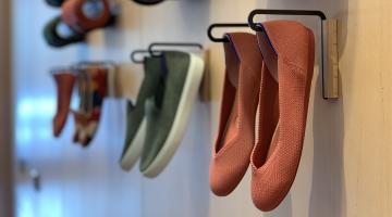 Rothy's shoes hanging on the wall in San Francisco store
