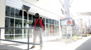 Worker cleans handrails at Nebraska Crossings