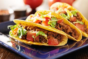 Beef tacos on a blue plate
