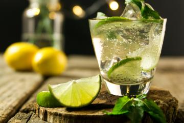 Margarita drink in a clear glass with slice of lime