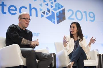 Scott Gravelle and Eurie Kim on stage at NRFtech