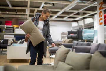 Woman check price of couch in store