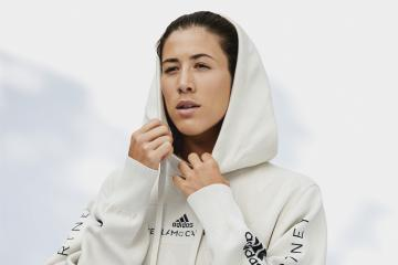 woman in Adidas recycled hoodie