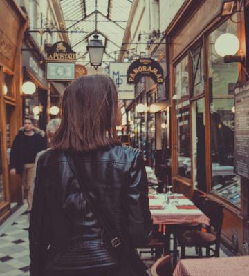 Unsplash woman walking through shopping experience