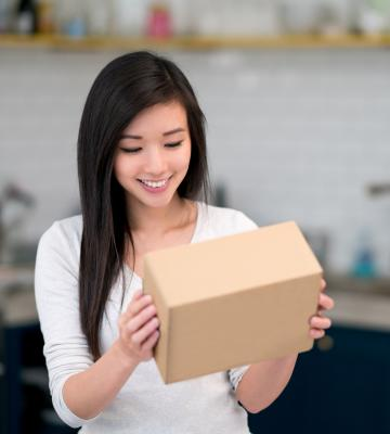 Woman looking at a box