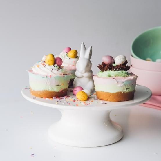 A plate with cupcakes and a chocolate bunny for easter