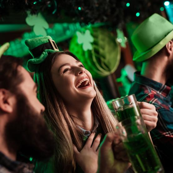 Woman laughing at St. Patrick's day celebrations